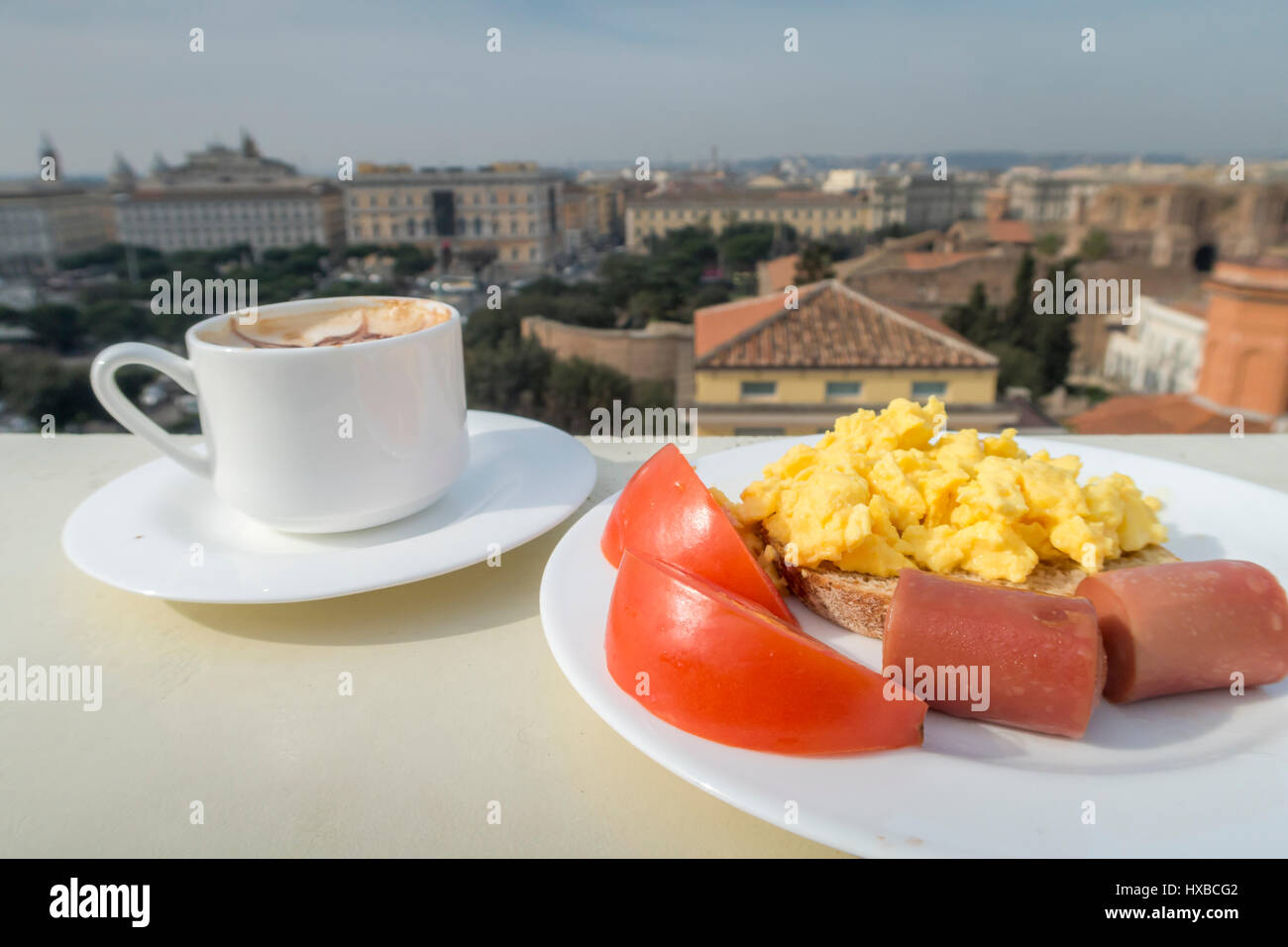 Healthy breakfast with tomato, sausage, scramble eggs and coffee - Stock Image
