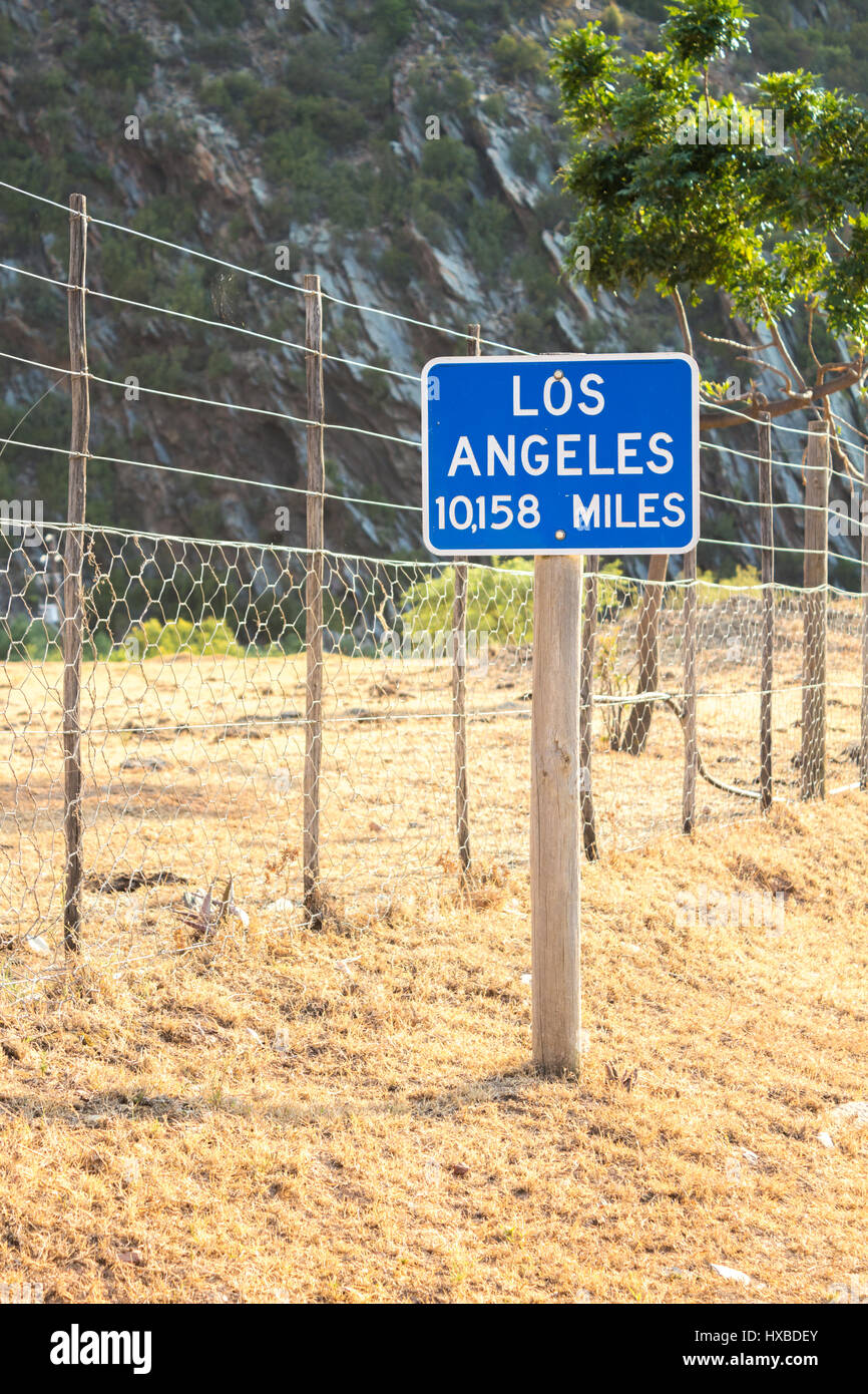 Abstract image of a sign post with Los Angeles 10,158 miles away on a South African farm - Stock Image