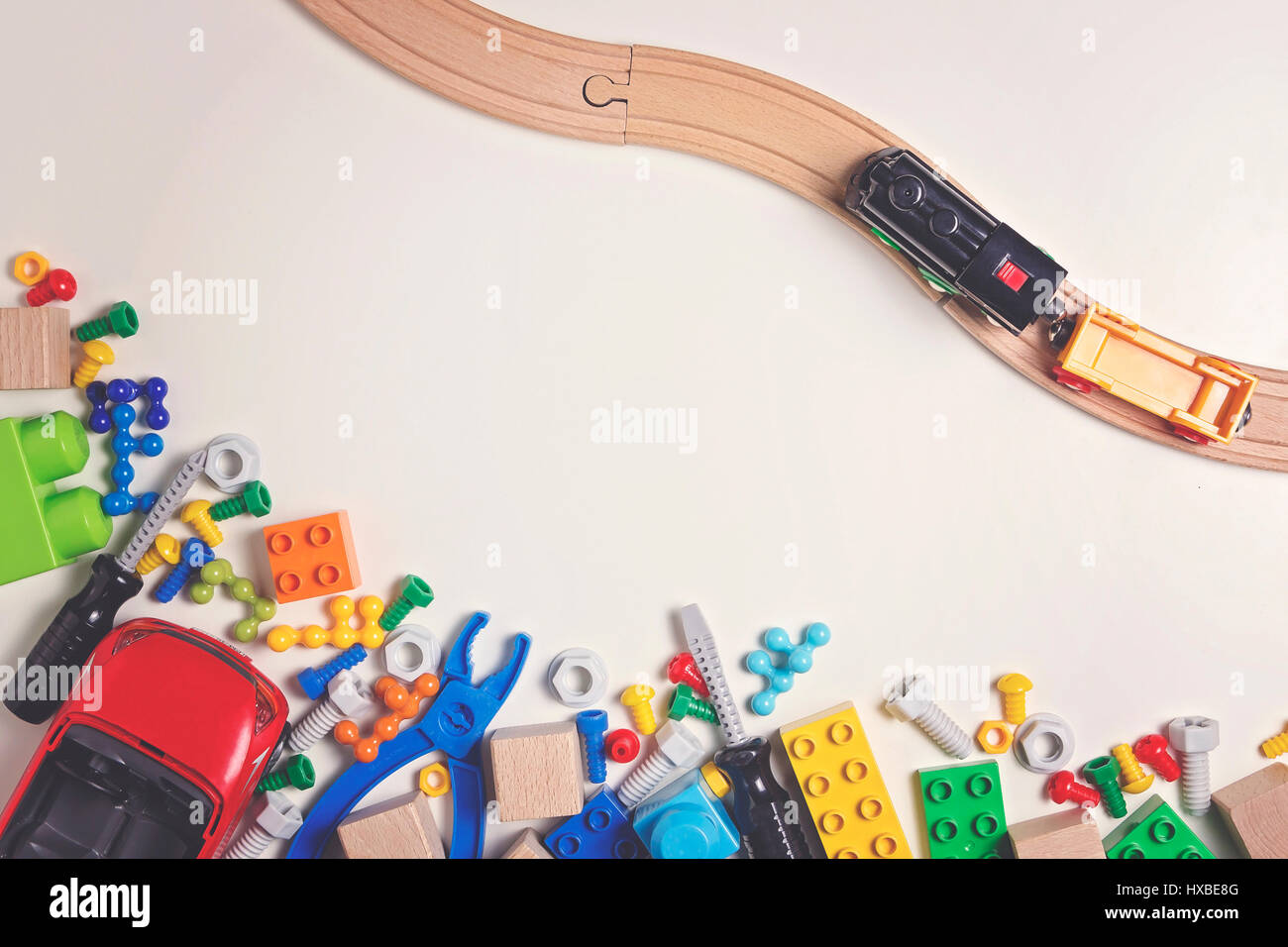 Colorful kids toys on white background as frame with copy space for text. Top view. Flat lay. Stock Photo
