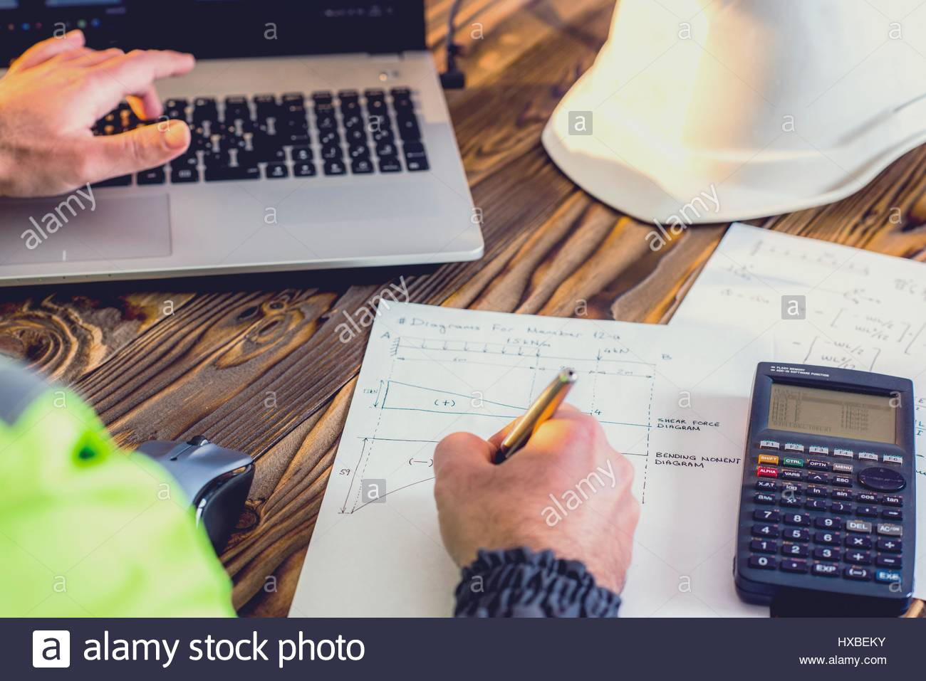 Civil design engineer is making structural analysis calculations civil design engineer is making structural analysis calculations using a scientific calculator ccuart Images