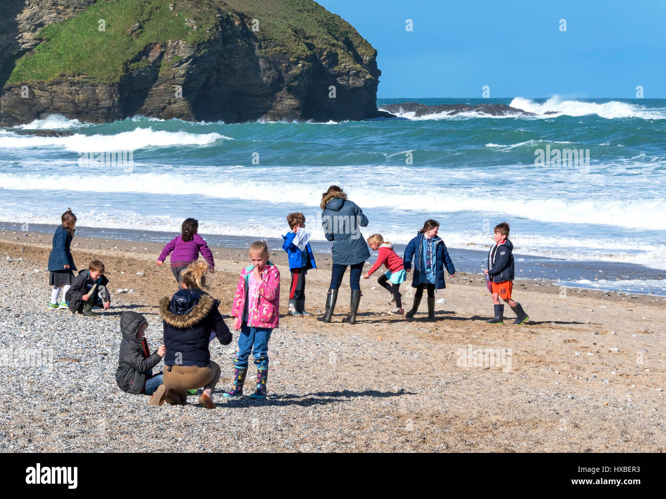 schoolchildren from portreath in cornwall, england, uk, have a lesson on the beach in spring sunshine, Stock Photo