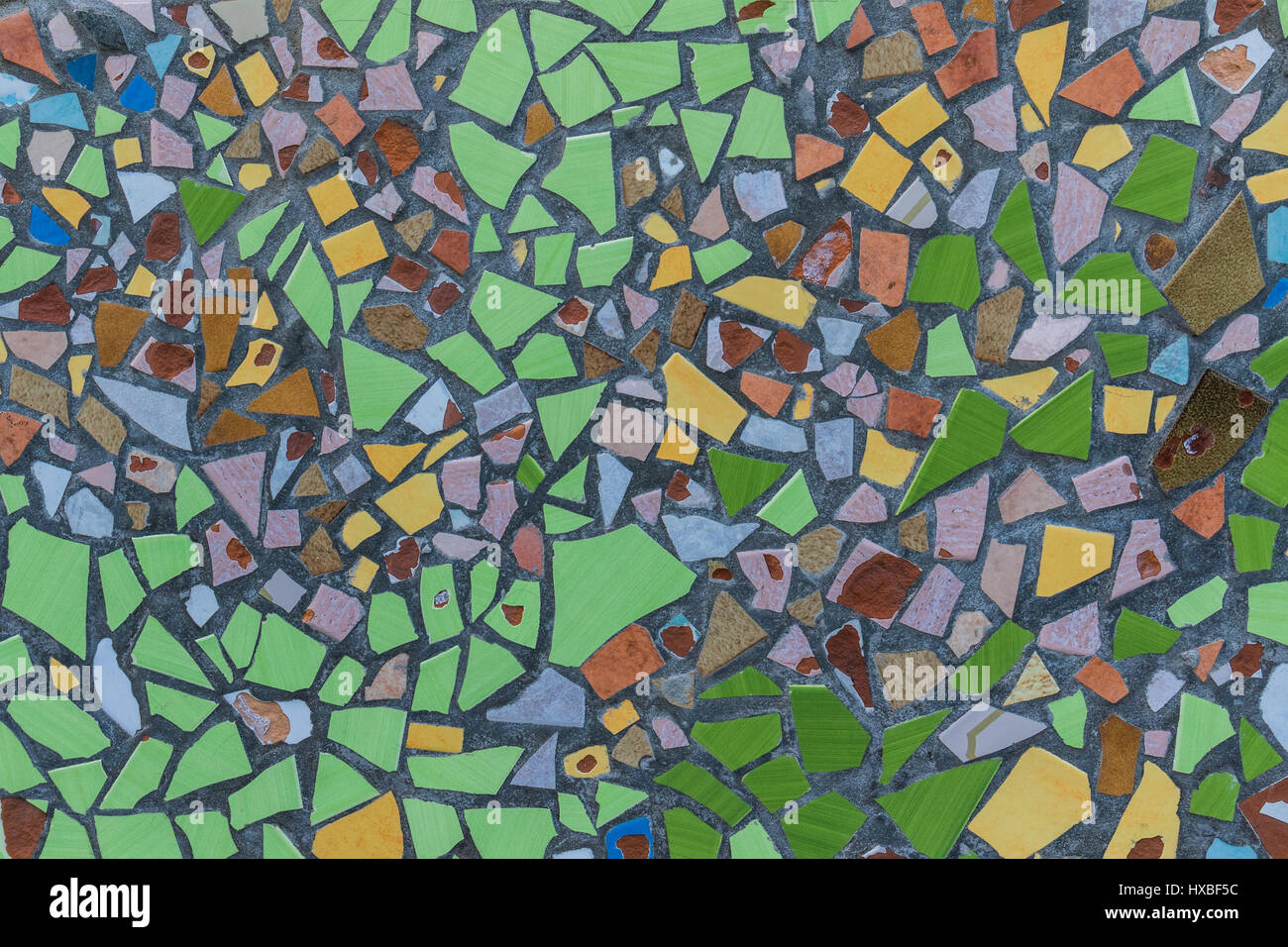 Colorful mosaic tiles house wall exterior - Stock Image