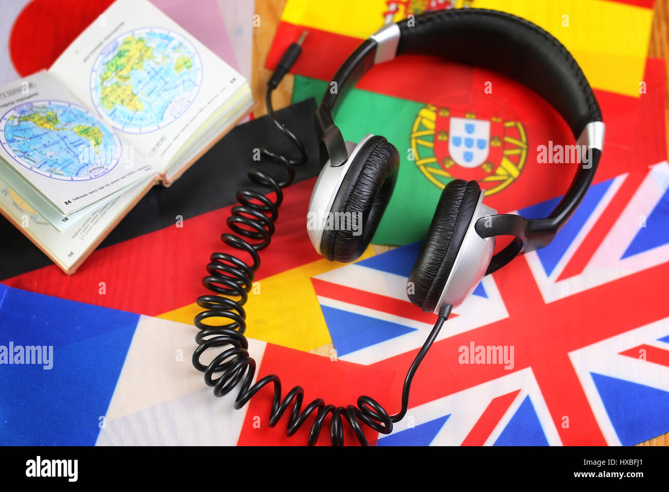 course language headphone and flag on a table Stock Photo