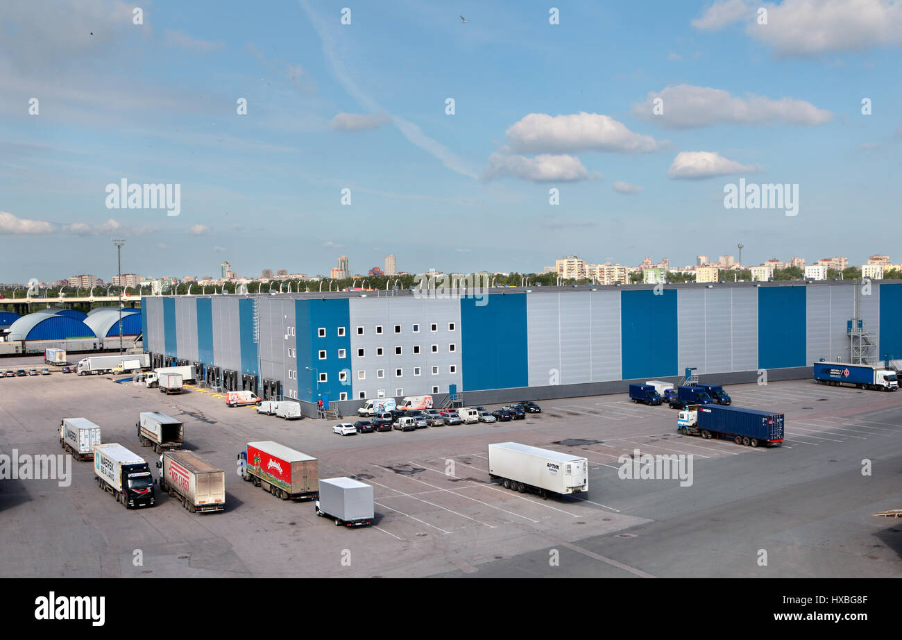 St. Petersburg, Russia - june 13, 2013: Warehouse logistics complex with loading and unloading docks, parking space - Stock Image