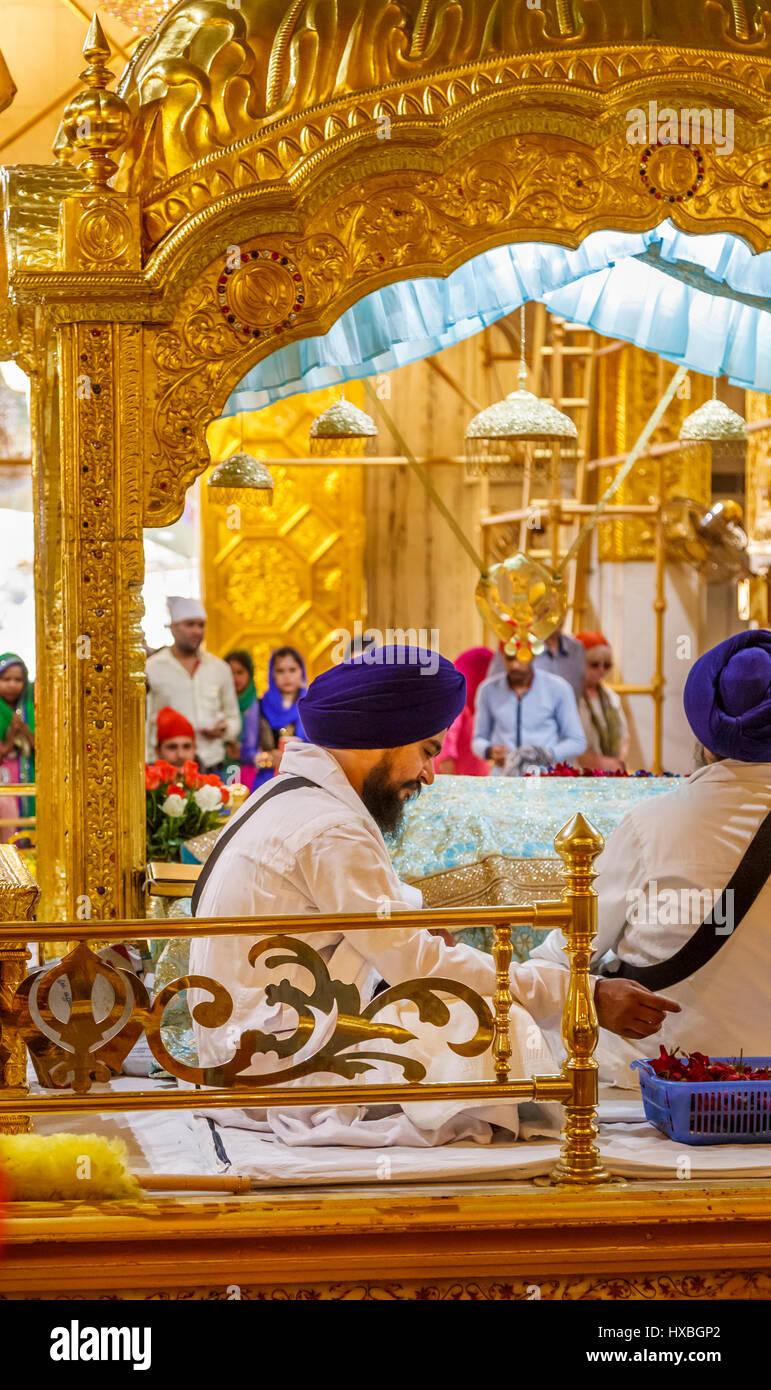 Sikh priest wearing a blue turban in Gurudwara Bangla Sahib, a Sikh temple in New Delhi, capital city of India, Stock Photo