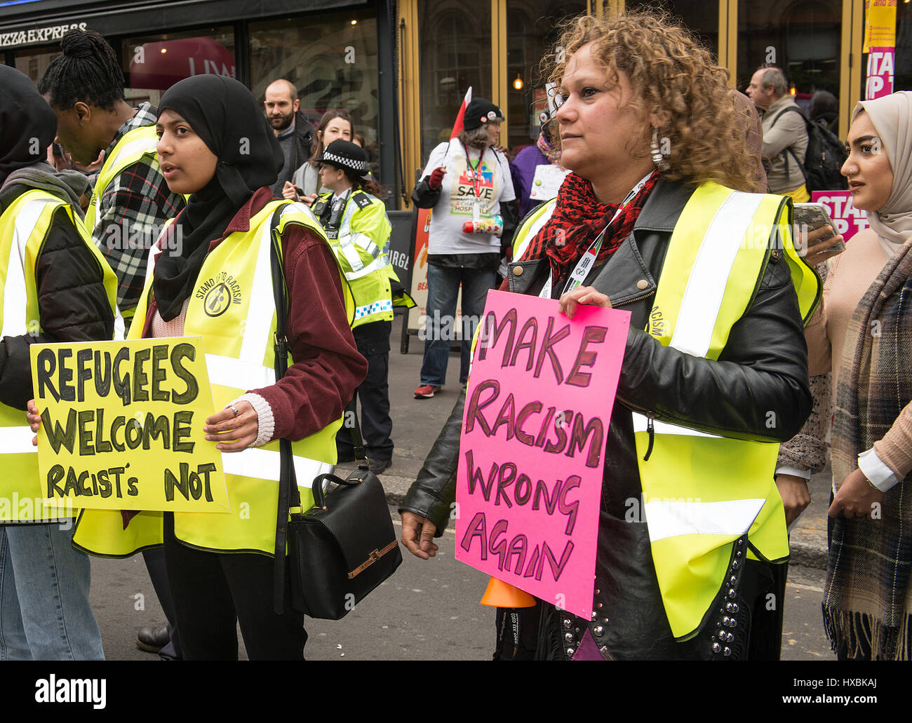 March Against Racism / UN Anti-Racism Day - thousands turn out for the anti racism - anti Donald Trump rally through - Stock Image