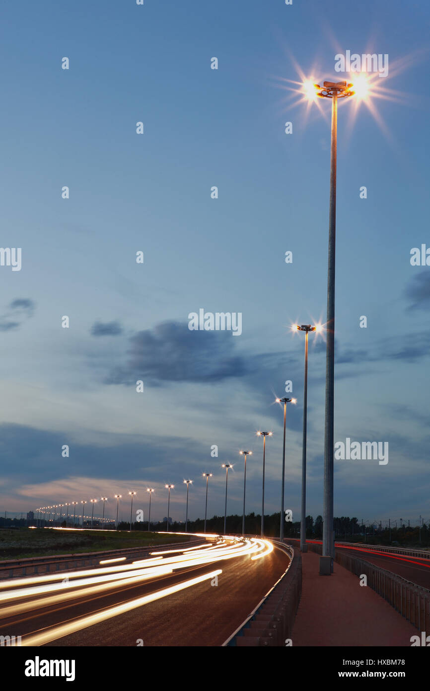 Lighting columns on the highway night lighting road track at night lighting columns on the highway night lighting road track at night lights vertical photo aloadofball Images