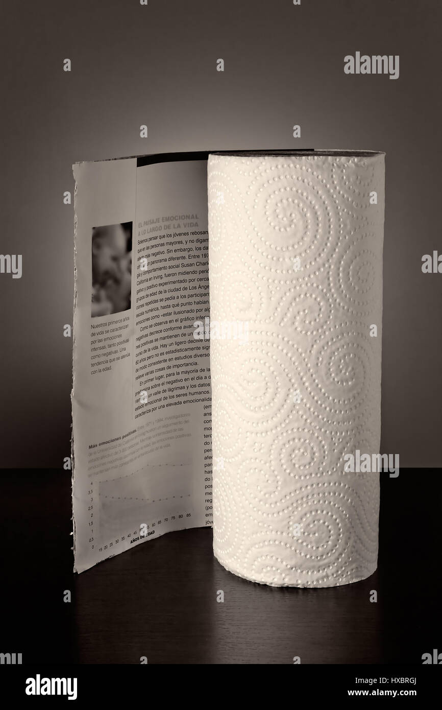 Kitchen paper as if it were a magazine. Visual metaphor. Vertical image. - Stock Image