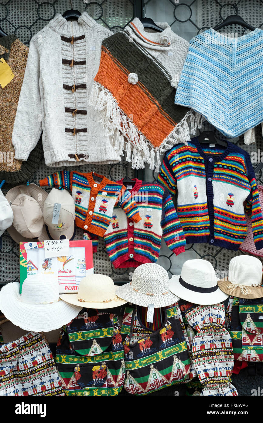 Souvenirs of Madeira hanging outside a tourist shop at Funchal - Stock Image