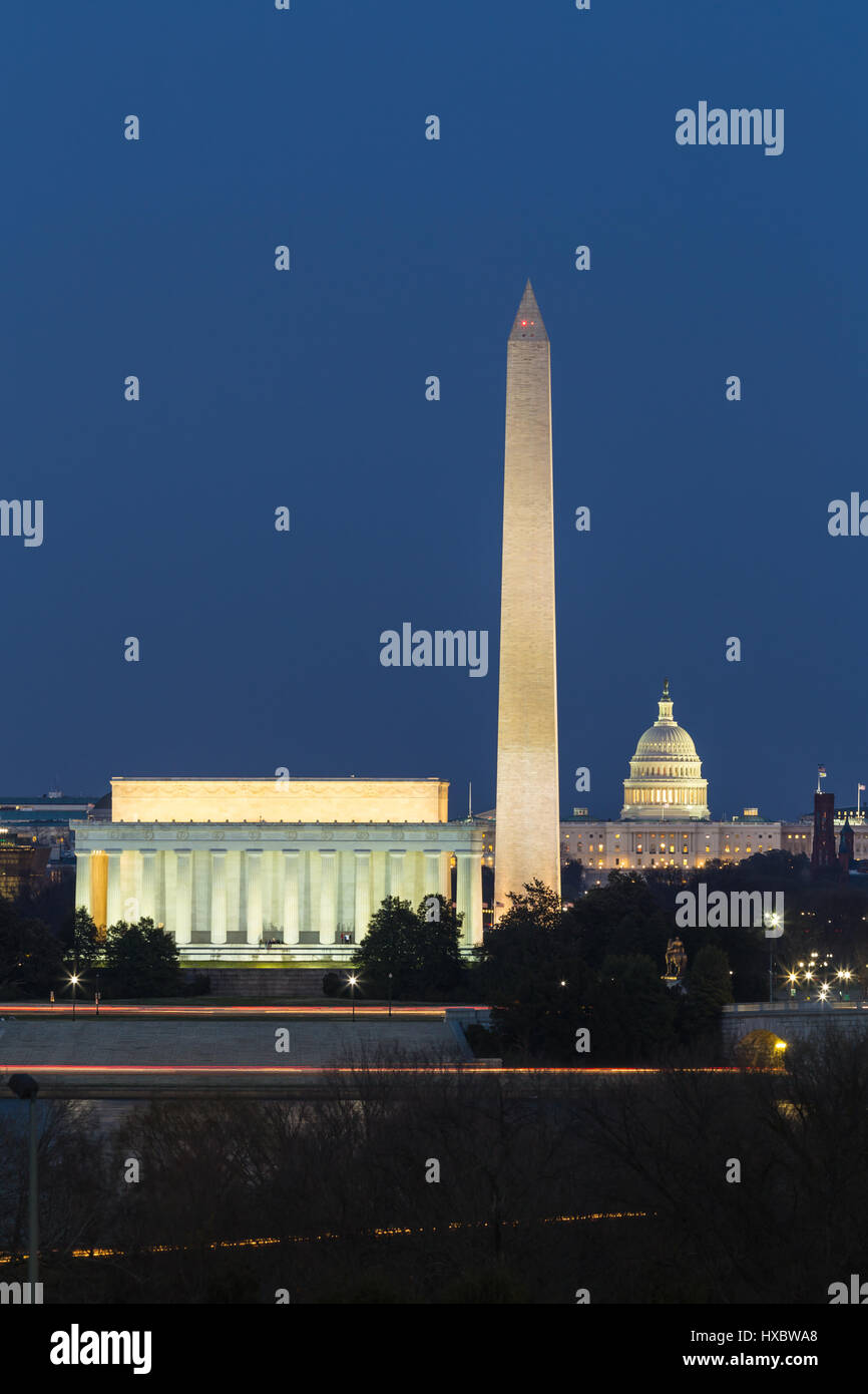 The Lincoln Memorial, Washington Monument, and US Capitol building illuminated during evening twilight in Washington, - Stock Image