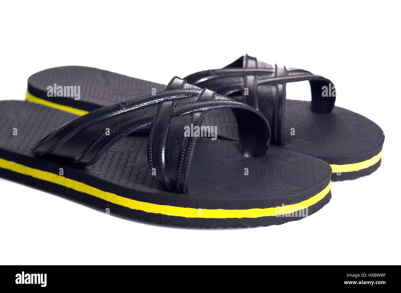 2e99885c135 Rubber embed with plastic sandal or slipper with black and yellow stripes  isolated on white (Property release of visible logo trademark is attached)