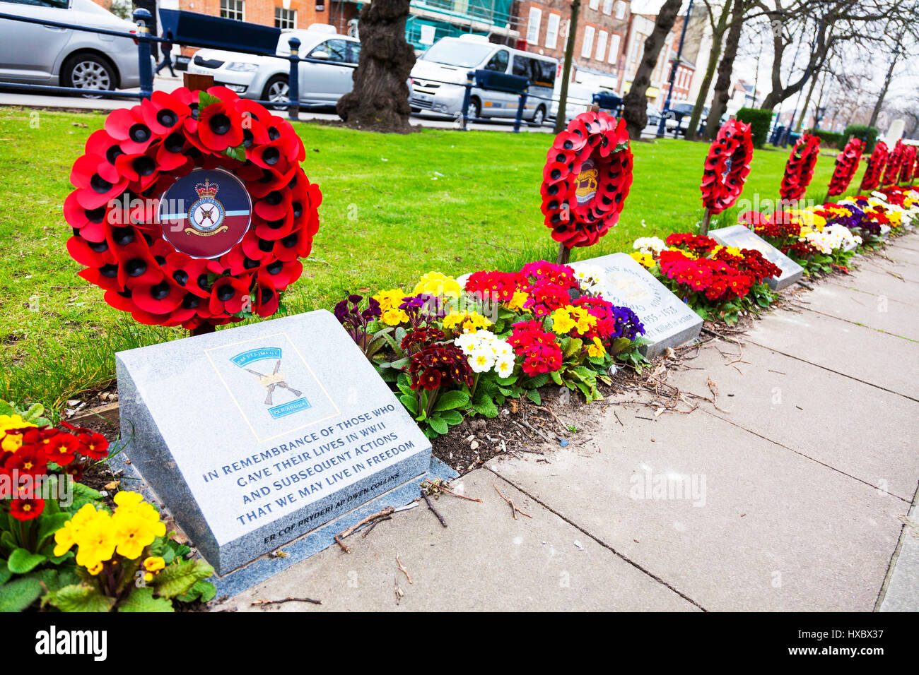 Poppy wreath poppy wreaths for poppy day WW2 memorial stone for soldiers poppy display UK England mark of respect - Stock Image