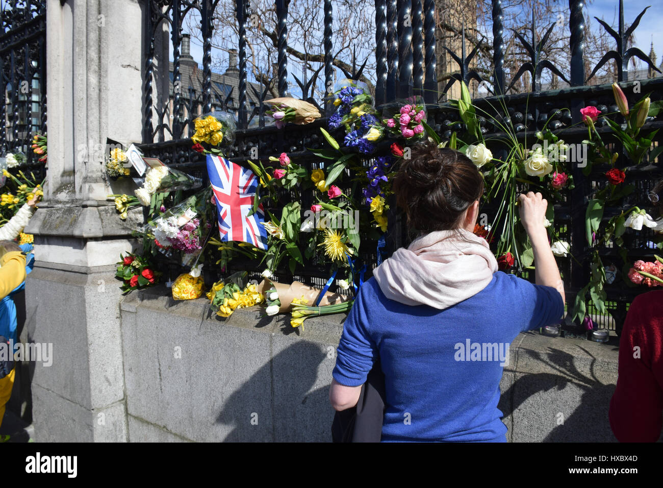 Floral tributes outside Parliament for the victims of the terrorist attack on 22 March 2017. Unite for Europe (anti - Stock Image