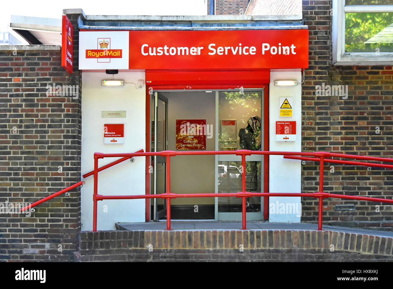 Royal Mail Customer Service Point with exterior wheelchair ramp disabled disability access Harlow Essex UK - Stock Image