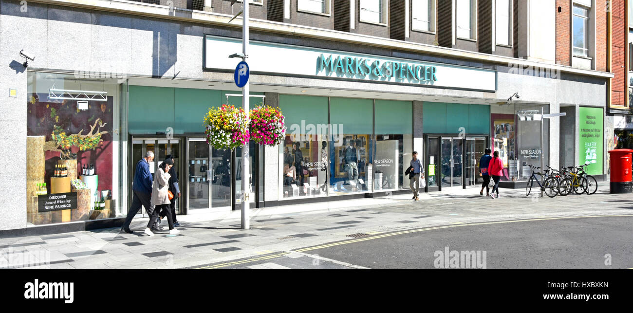 Marks and Spencer M&S shop front windows in Slough Berkshire UK high street retail shopping centre shoppers - Stock Image