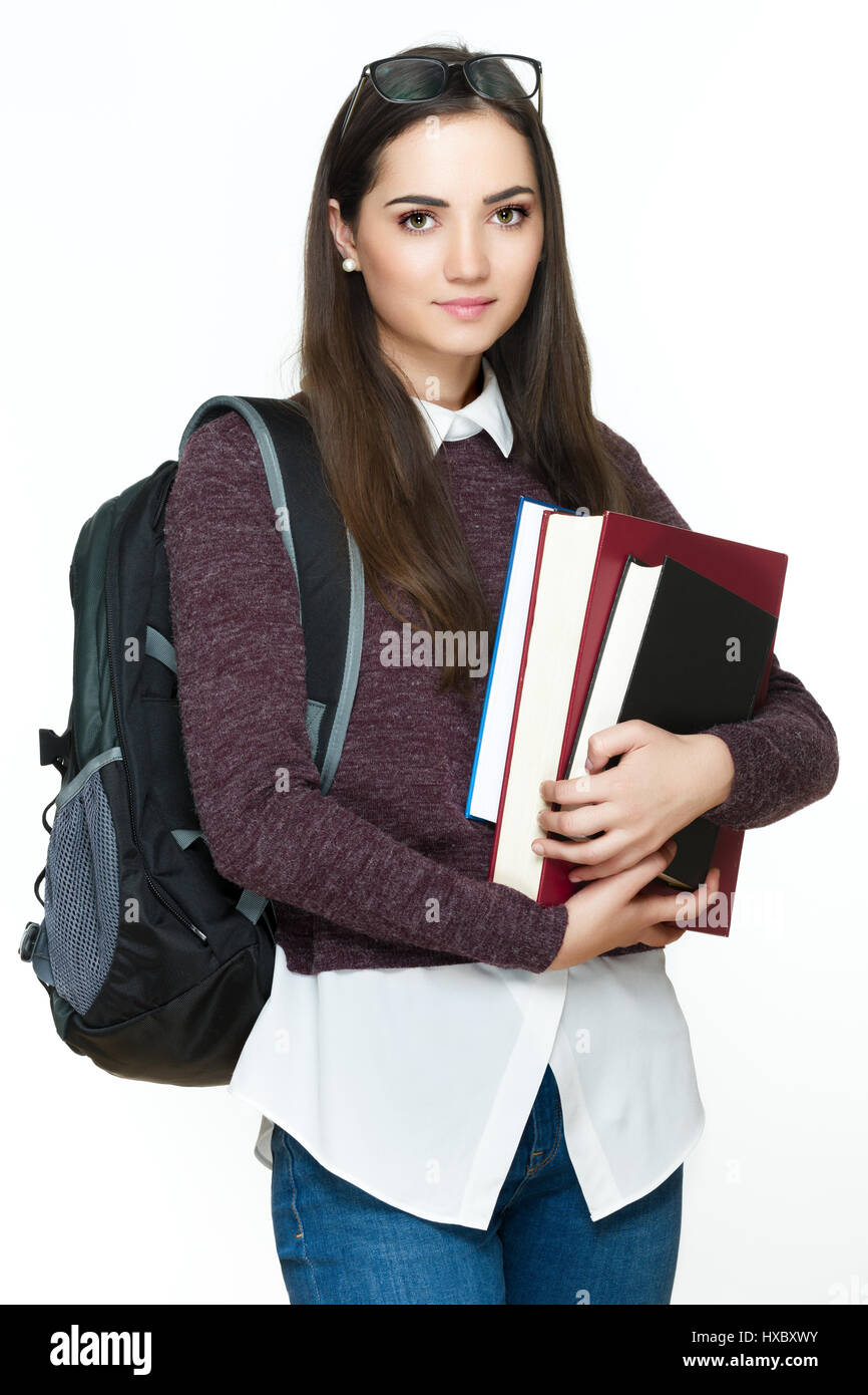 Happy student life. Attractive cheerful young female student holding books, isolated on white background. - Stock Image