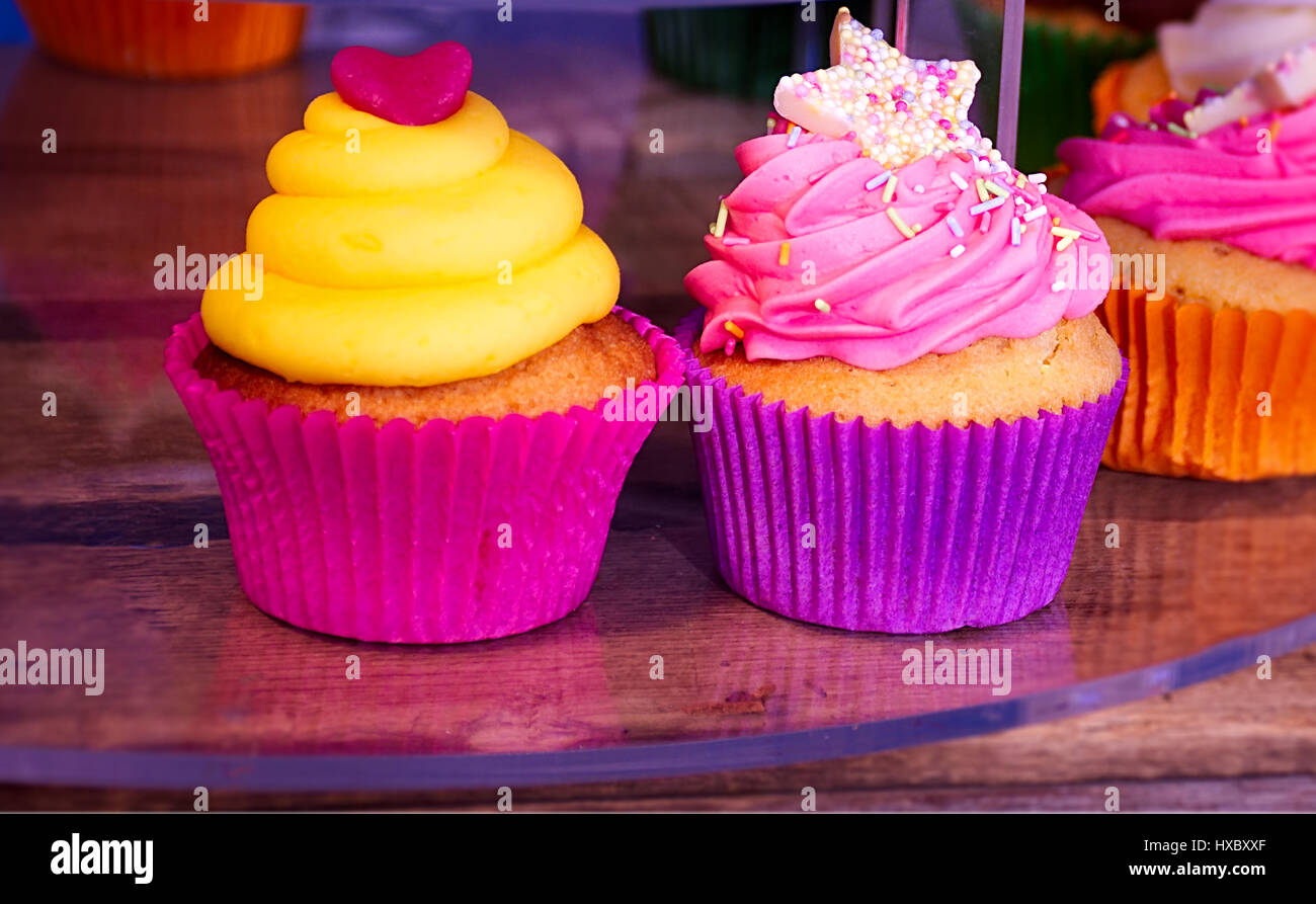 Colourful,traditional cupcakes on street market stall in Stoke on Trent,Staffordshire,United Kingdom. - Stock Image