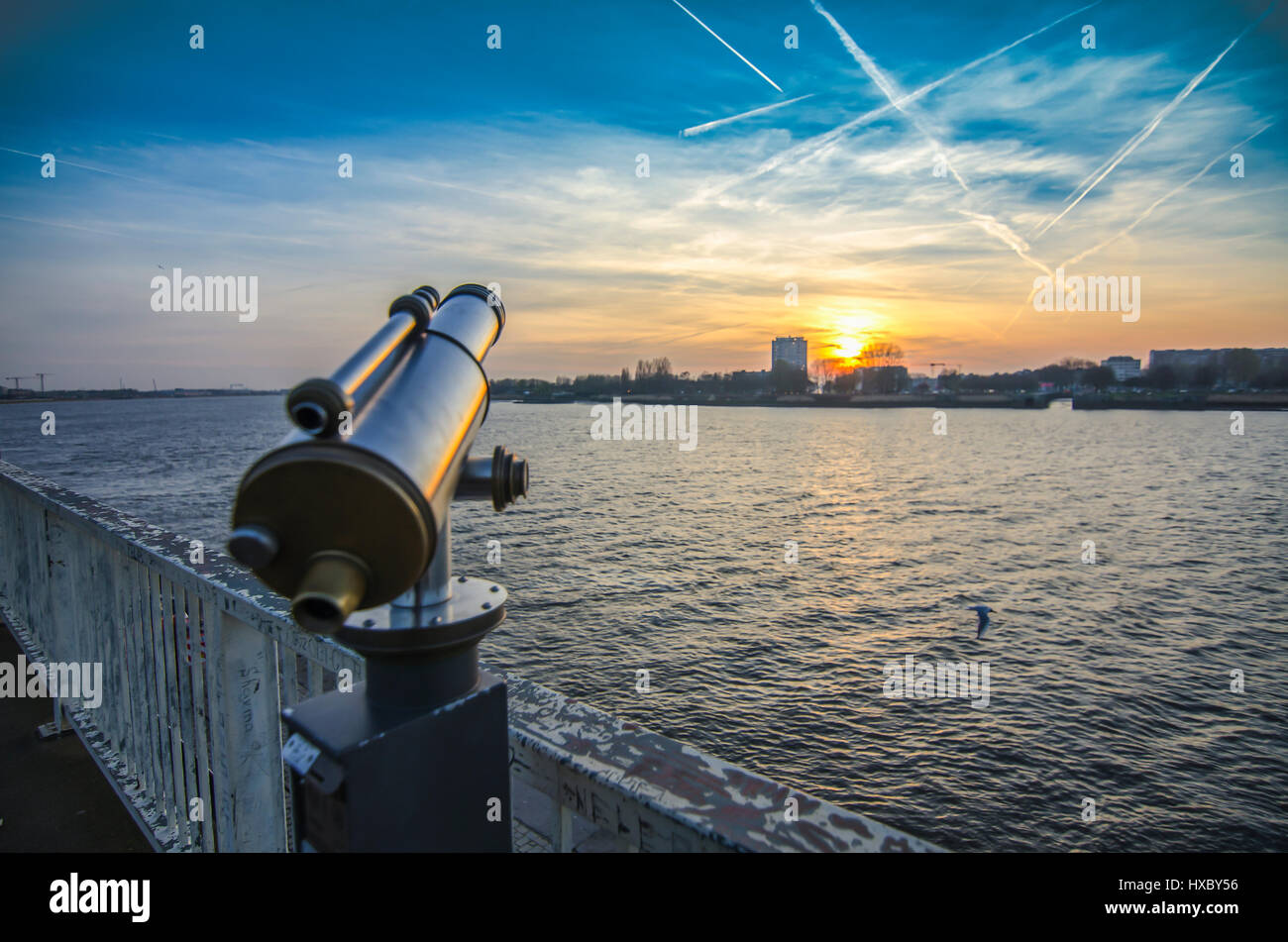 View of the Shelda River from the viewing platform of the wharf of Antwerp. Telescope with landscape - Stock Image