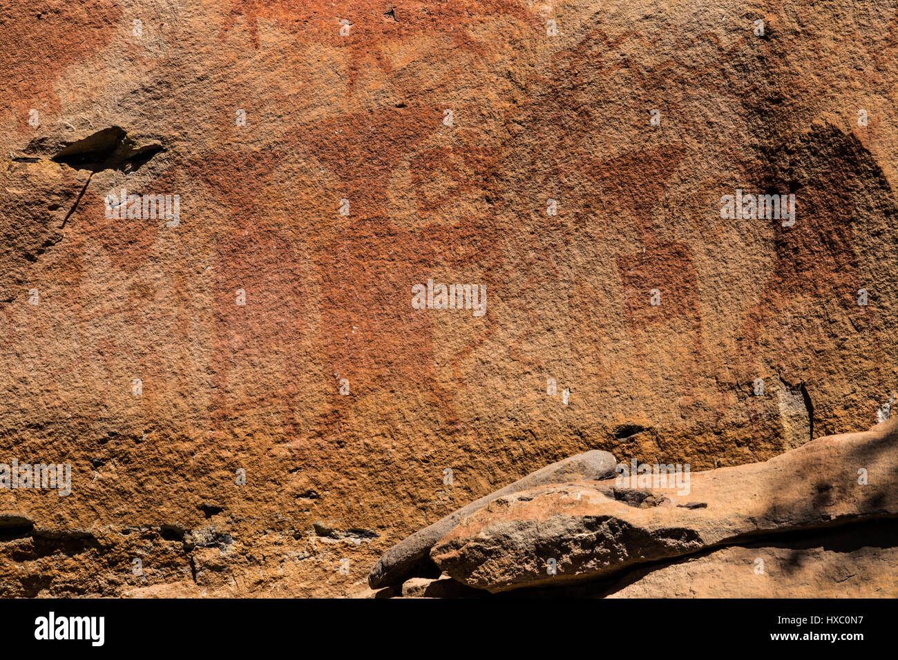 Pha Taem Cave Art - Pha Kham, these pale paintings were probably made with pigment, red was used to connect rituals - Stock Image