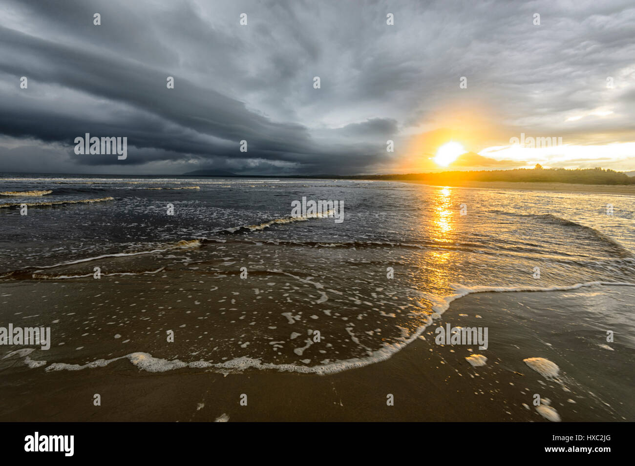 Sunset and stormy weather at Seven Mile Beach, Gerroa, Illawarra Coast, New South Wales, NSW, Australia - Stock Image