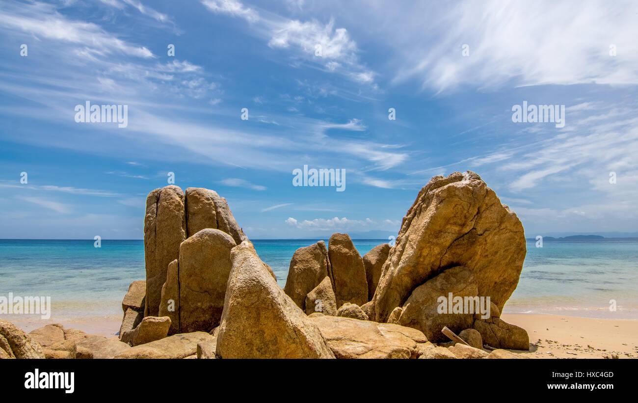 Large Golden Sand Stone Rocks On A Tropical Island Beach Looking Out To A Calm Paradise Sea Stock Photo Alamy Rocks stones horizon coast sand sea