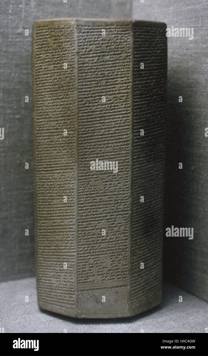 The Taylor Prism. The Sennacherib Prism. Library of Ashurbanipal. Hexagonal clay prism foundation record list campaigns - Stock Image