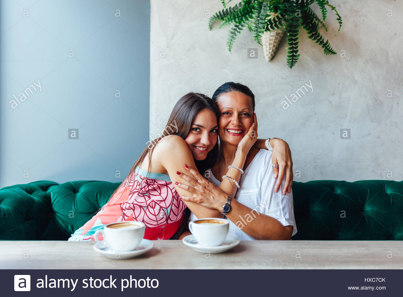 Love of mother and daughter. Aged woman and her adult daughter drinking coffee at cafe. Mothers day. - Stock Image