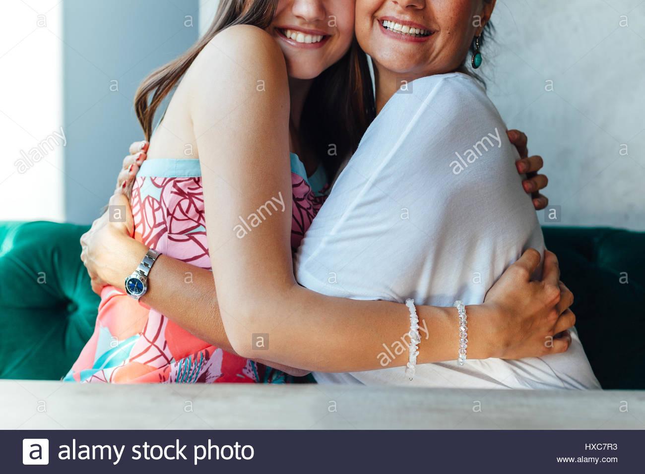 Embrace of mother and daughter in closeup - Stock Image