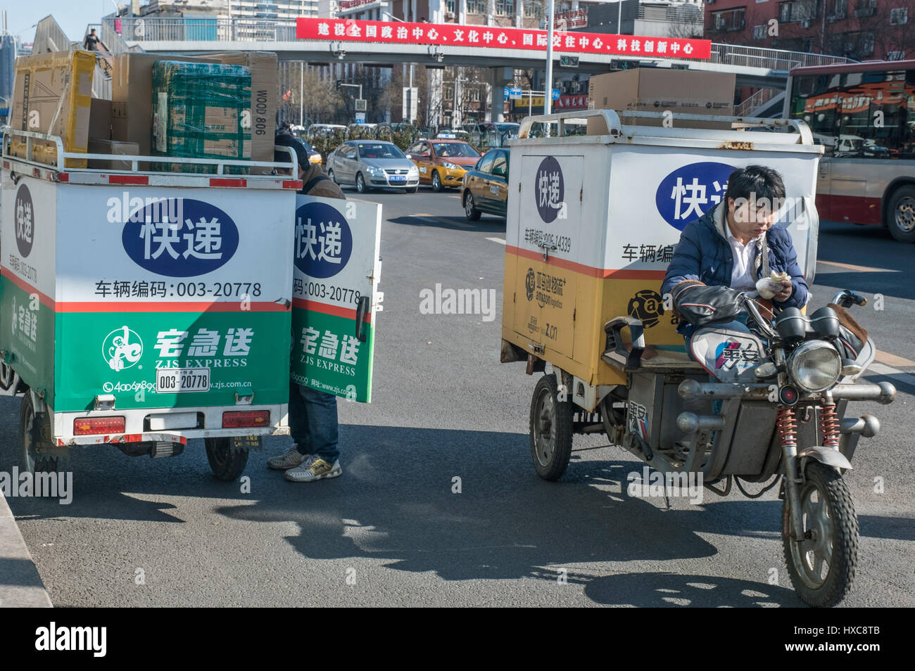 The express-delivery motorcycles shuttle back and forth in the street in Beijing, China. 27-Mar-2017 - Stock Image