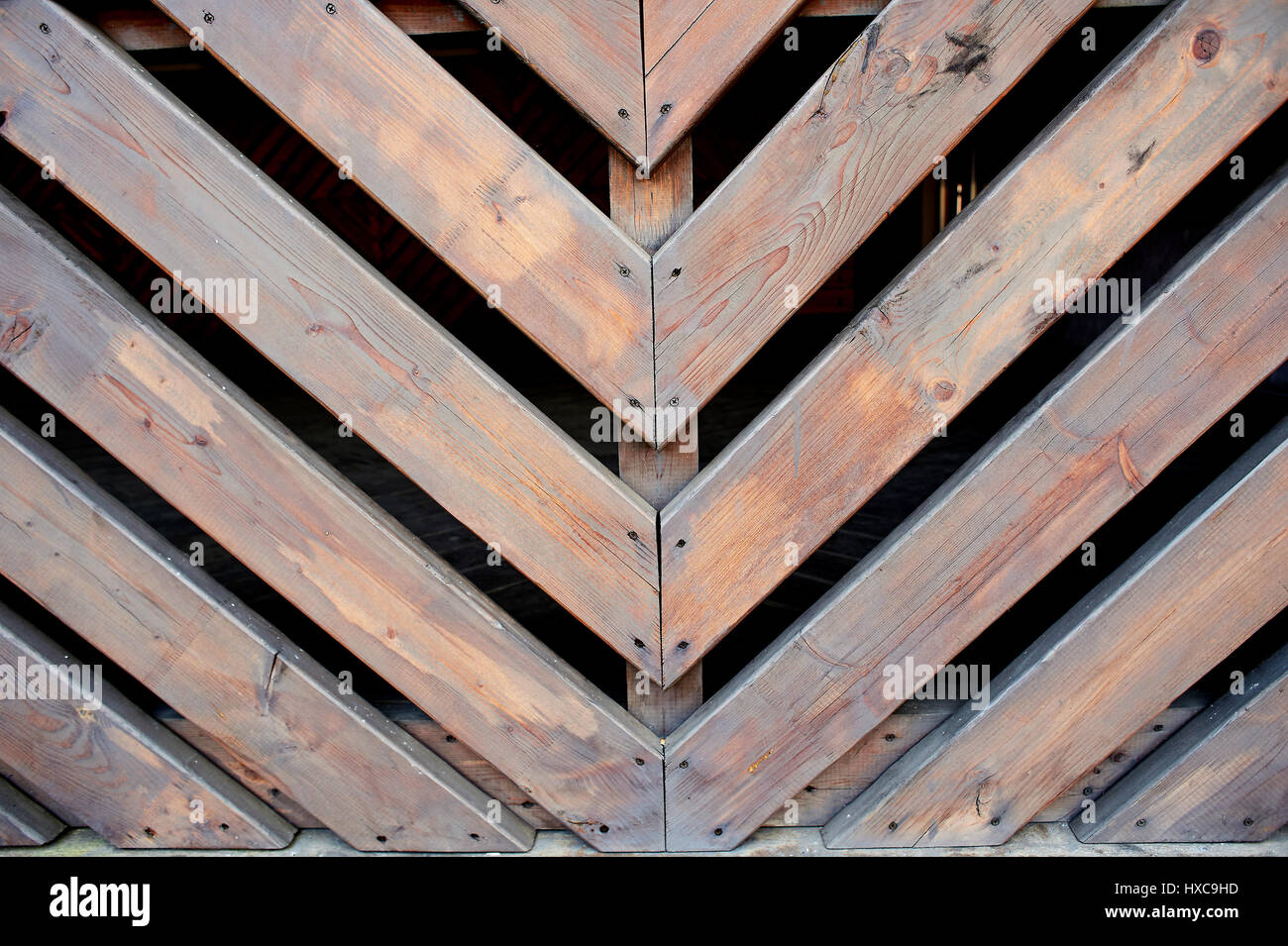 Oblique wooden slats. Bonded at an angle of 45 degrees. Fence, fencing - Stock Image