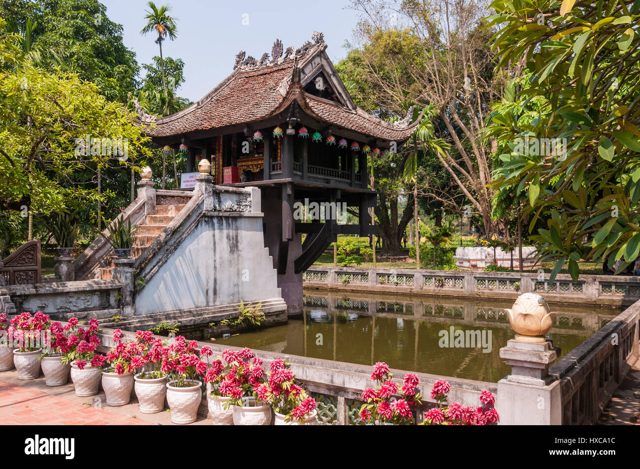 One Pillar Pagoda exterior and large pond on a sunny day, Hanoi, Vietnam - Stock Image