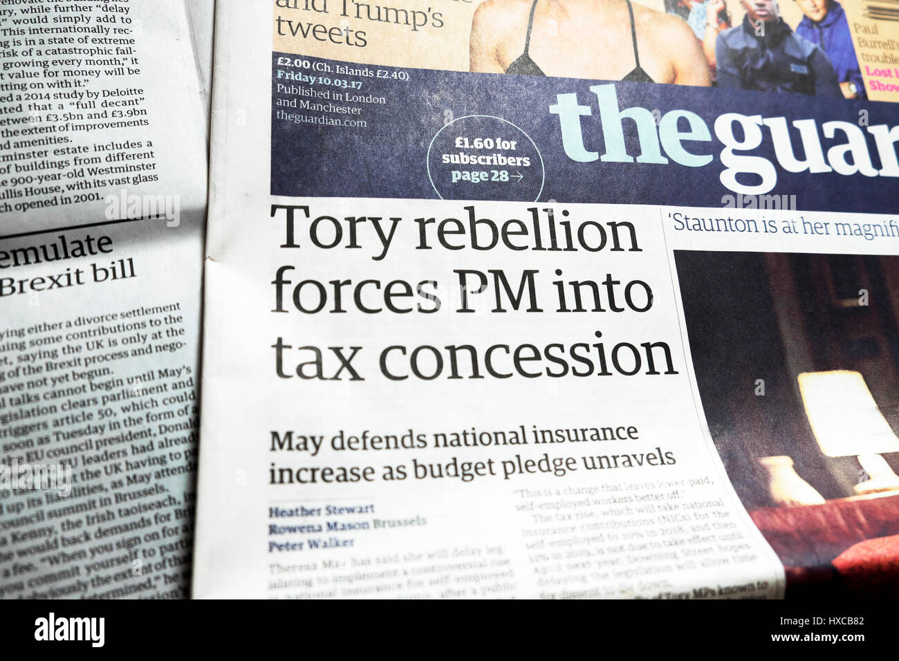 'Tory rebellion forces PM into tax concession'  Guardian newspaper article headline 10 March 2017 London - Stock Image