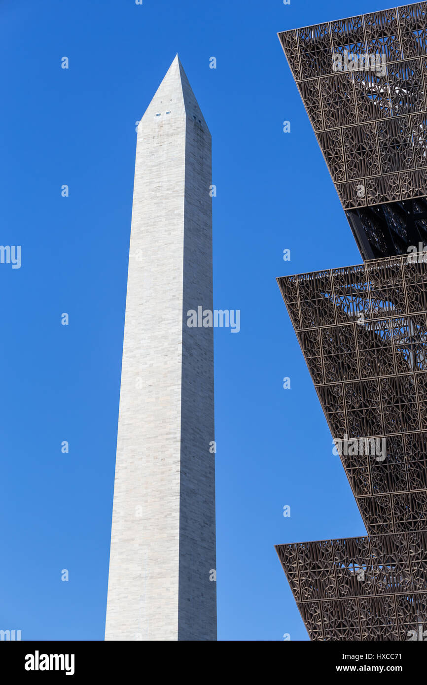 The angular metal architecture of the National Museum of African American History and Culture contrasts with the - Stock Image