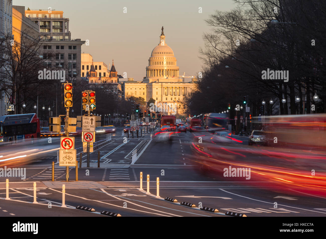 Traffic creates light trails and motion blurs leading to the US Capitol Building on Pennsylvania Avenue in Washington, - Stock Image