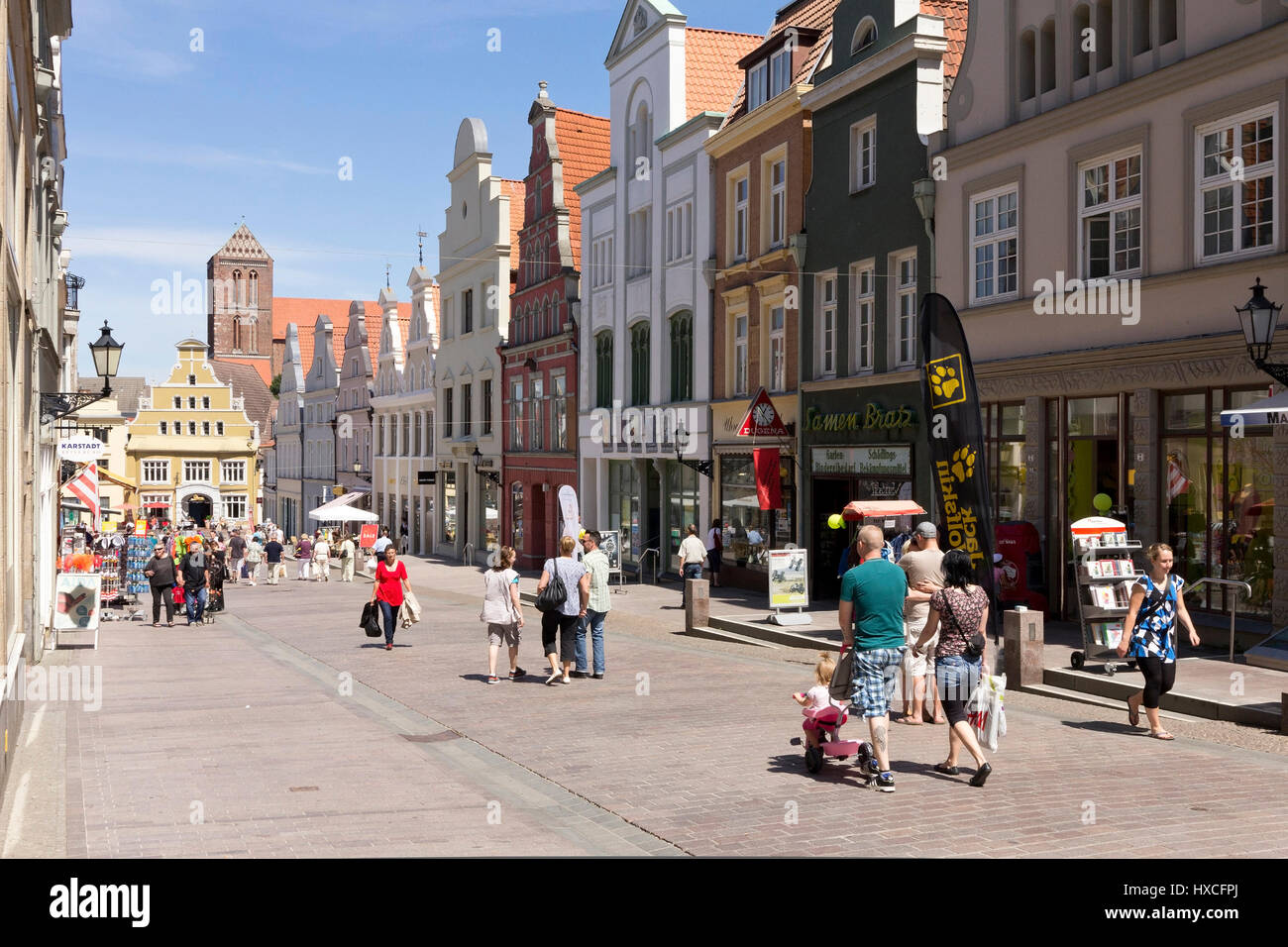 Business houses in a shopping street in the Old Town of Wismar, Commercial buildings in a shopping street in the - Stock Image