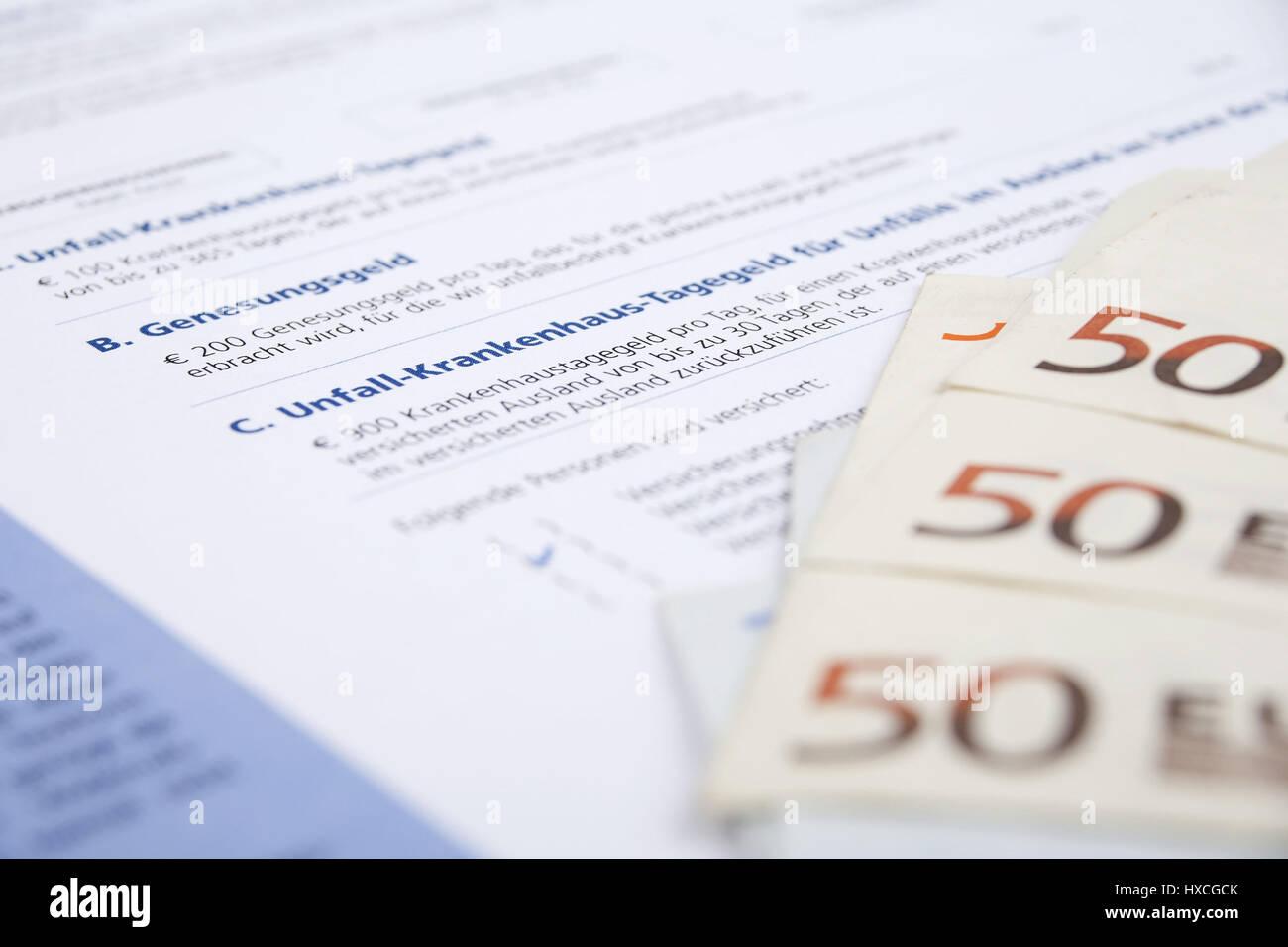 Insurance policy of an accident insurance with bank notes, Insurance policy of accident insurance with bank notes  , Versicherungsschein einer Unfallv Stock Photo