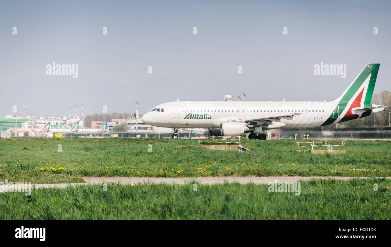 Milan, Italy. 27th Mar, 2017. An Alitalia commercial airplane takes off from Milan's Linate airport. Linate - Stock Image