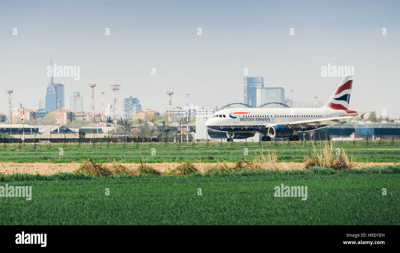 A British Airways commercial airplane takes off from Milan's Linate airport. Linate is a main hub for Alitalia servicingStock Photo