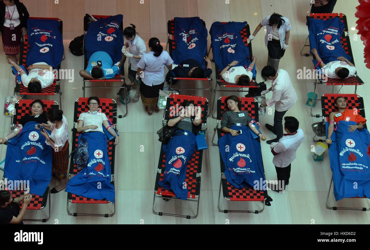 Vientiane, Laos. 28th Mar, 2017. Local people donate blood during a blood donation activity in Vientiane, Laos, - Stock Image