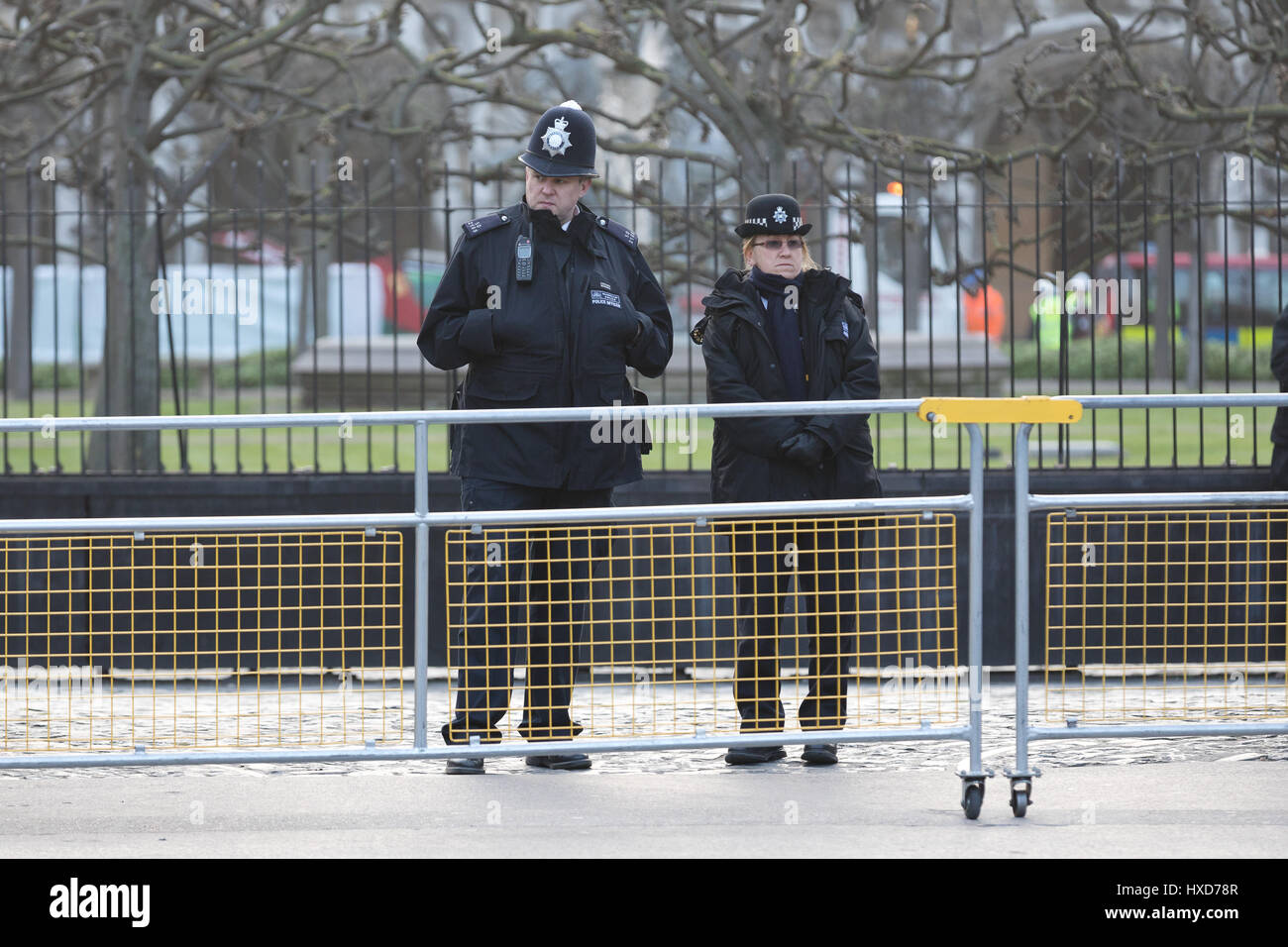London, UK. 28th March 2017. Unarmed police officers stand at the gates outside Parliament in Westminster , in response Stock Photo