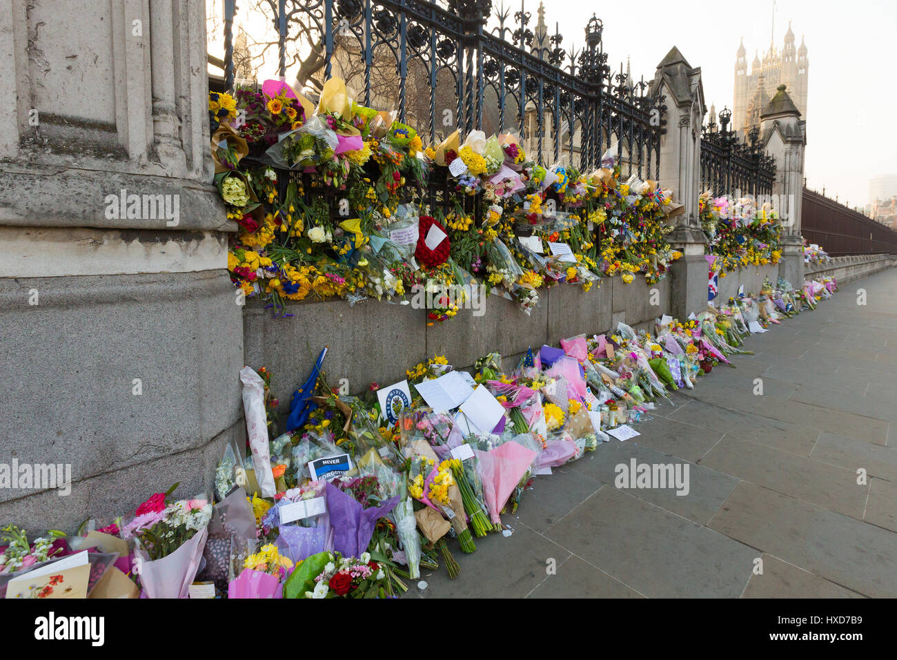 London, UK. 28th March 2017. Flowers and tributes in Parliament Square opposite Parliament in Westminster , in response - Stock Image