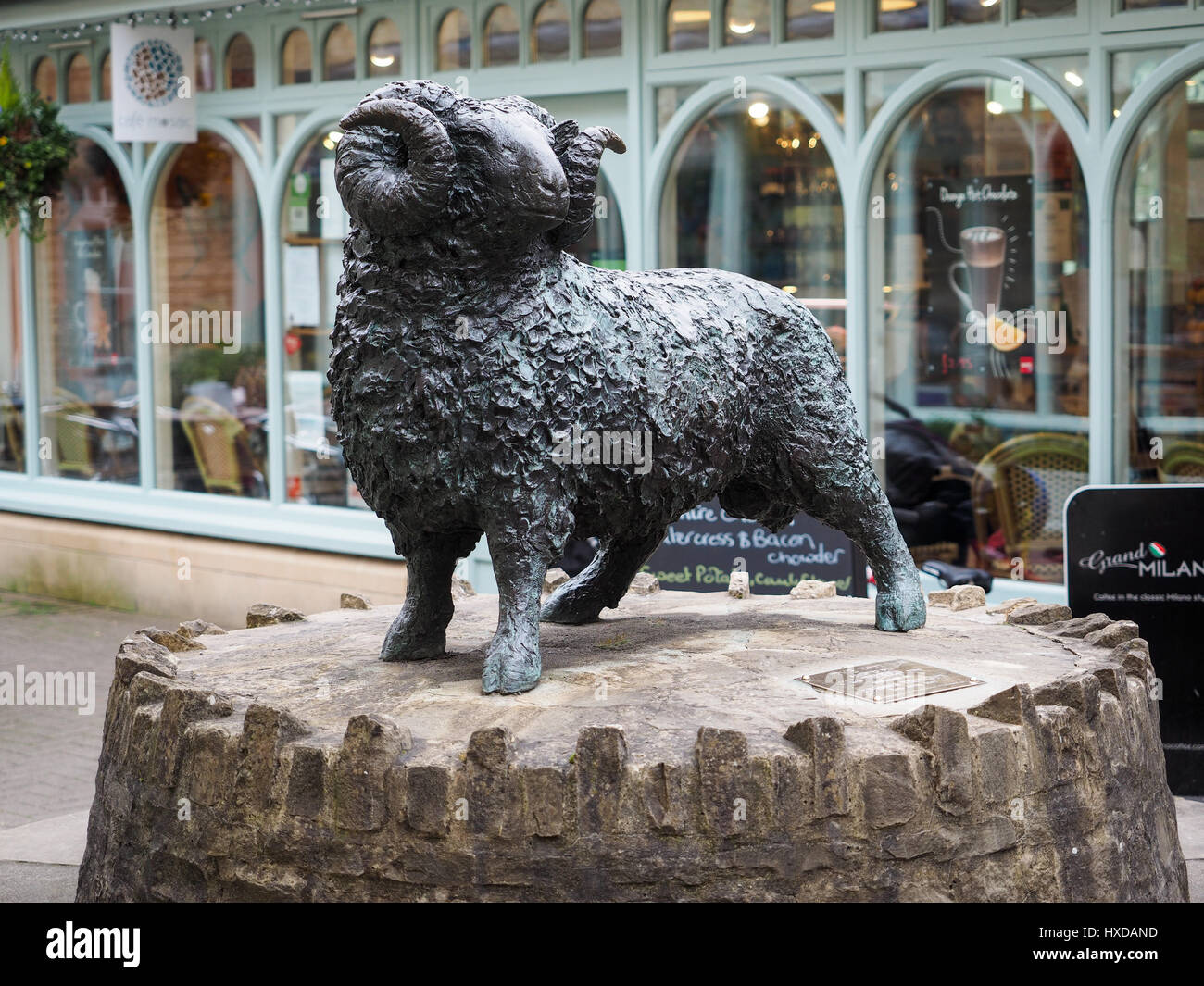 a view of Jill Tweed's black ram statue sculpture in the Woolmarket Wool Market in the center centre of Cirencester - Stock Image