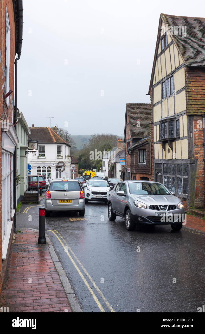 Busy traffic congestion in rural village of Ditchling near Brighton in Sussex UK - Stock Image
