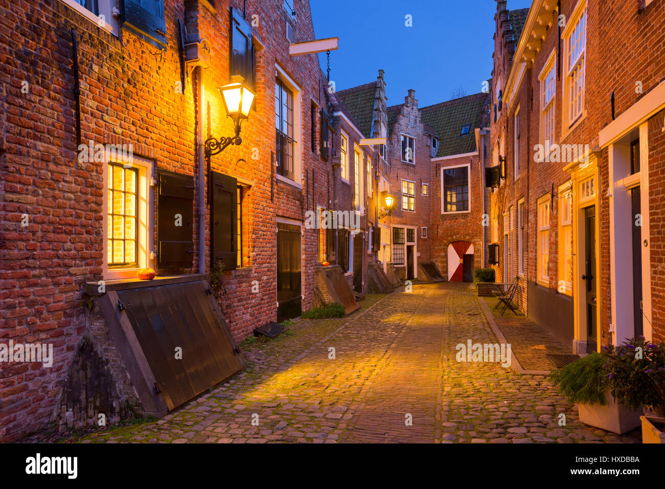 The historic alley of Kuiperspoort in Middelburg, The Netherlands at night. Stock Photo