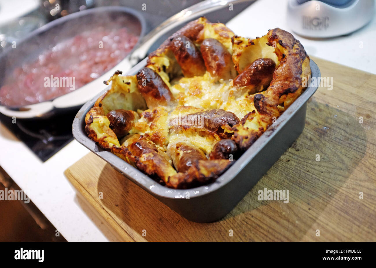 Home made Toad in the Hole sausages in batter meal - Stock Image
