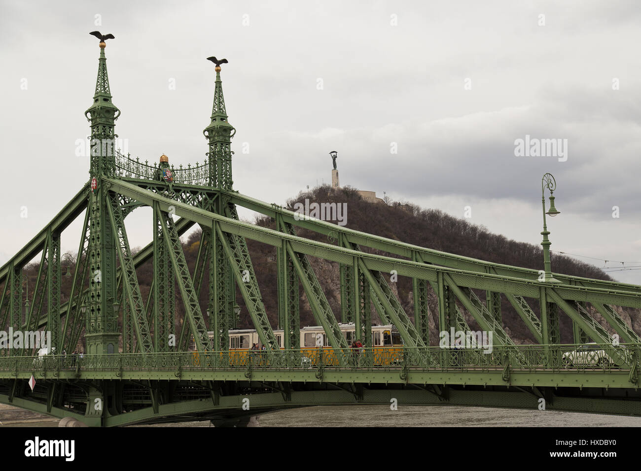 View of Liberty Bridge with tram crossing in Budapest Hungary Stock Photo