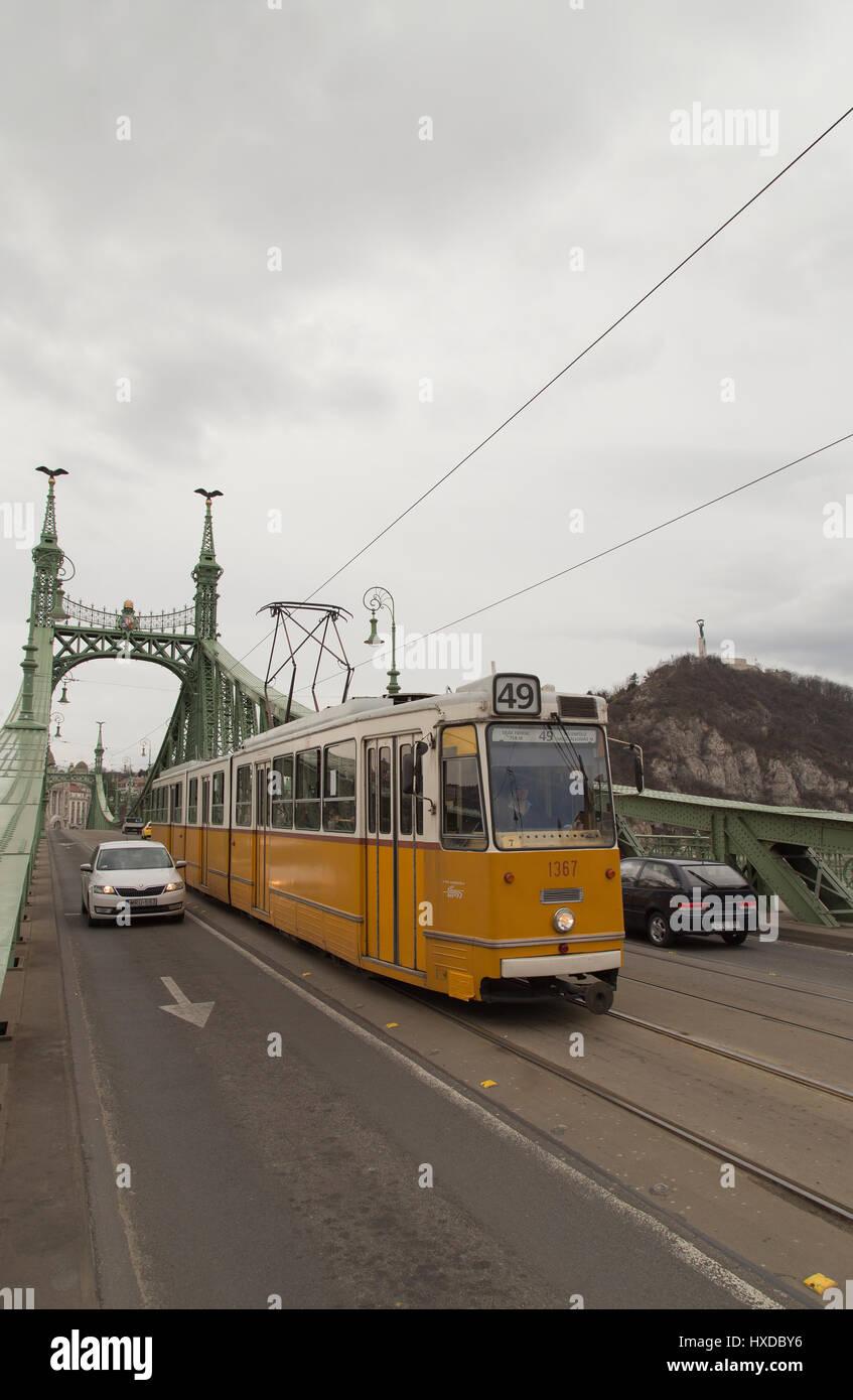 Tram crossing Liberty Bridge in Budapest Hungary Stock Photo