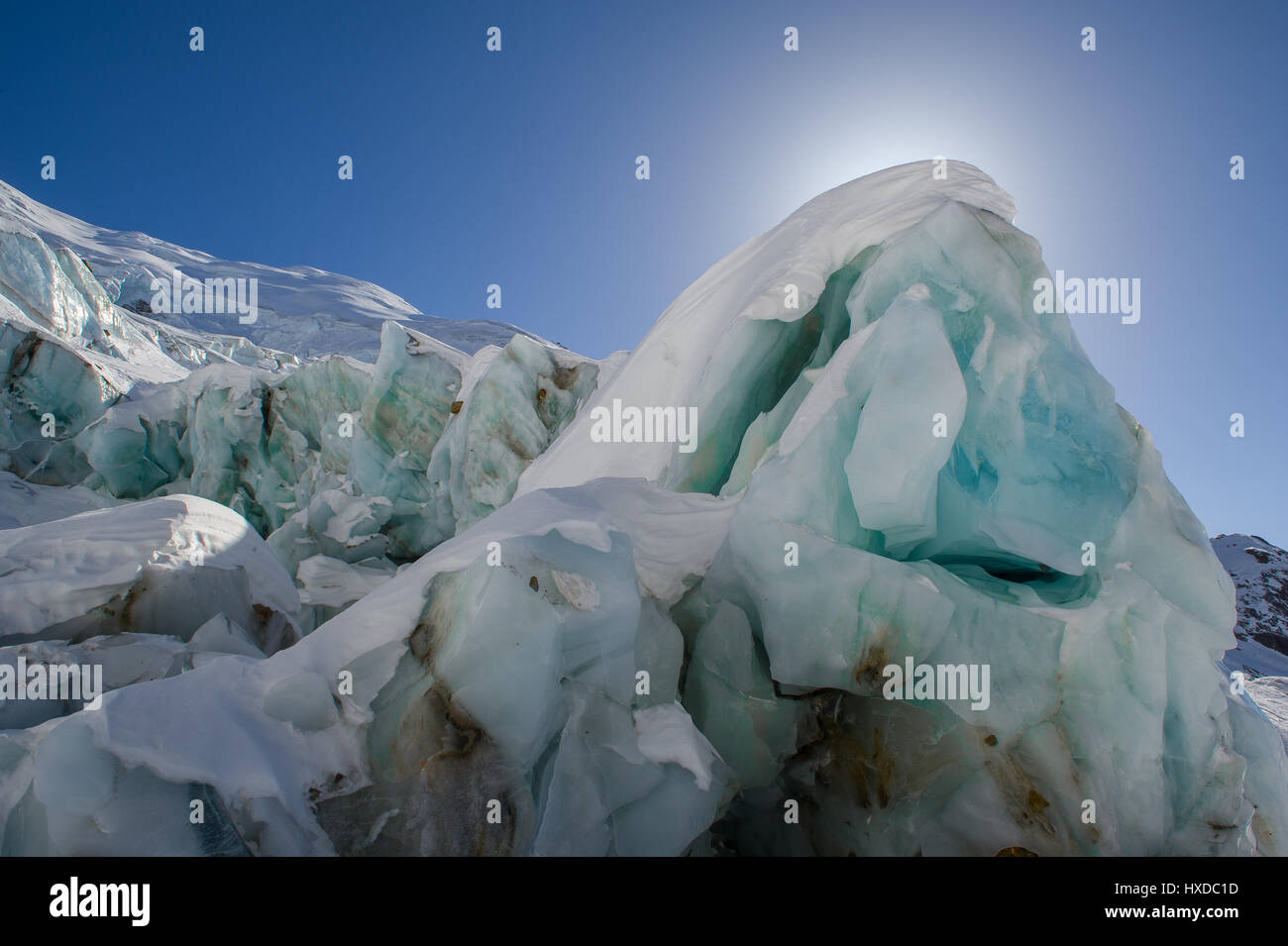 Ice block of an glacier in the alps - Stock Image