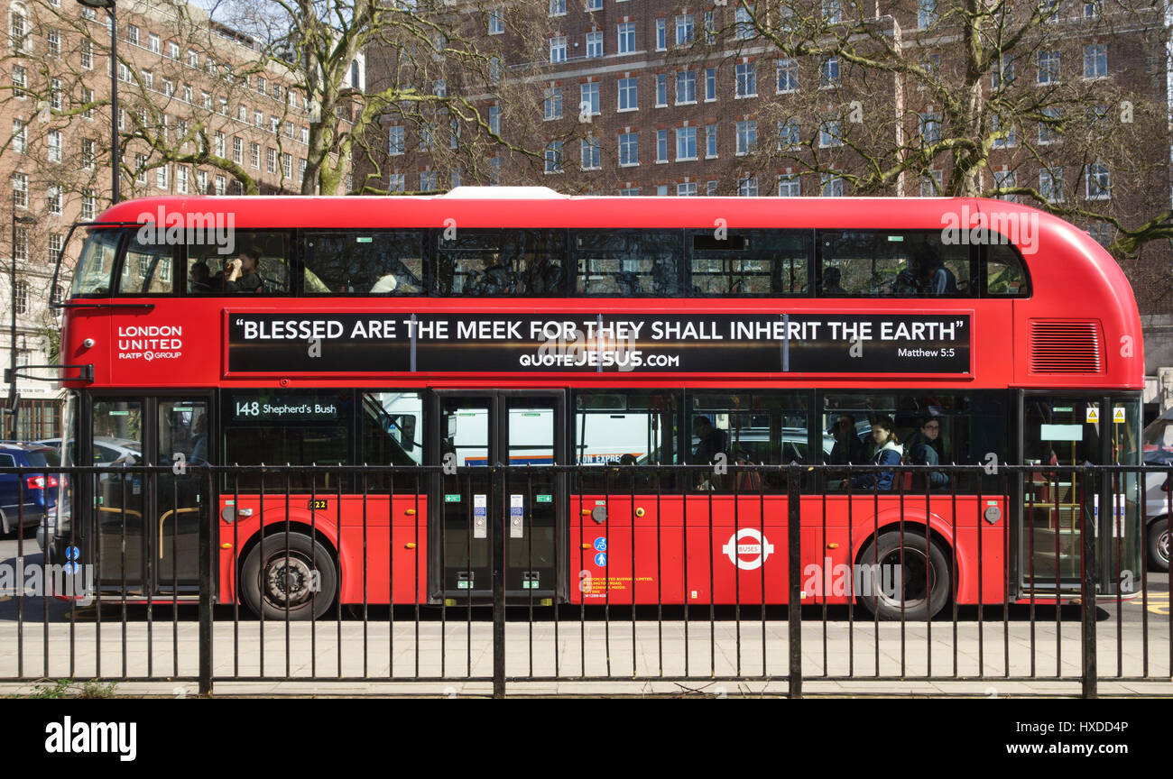 London, UK. One of the New Routemaster red buses introduced in 2012. It bears a biblical poster 'Blessed are - Stock Image