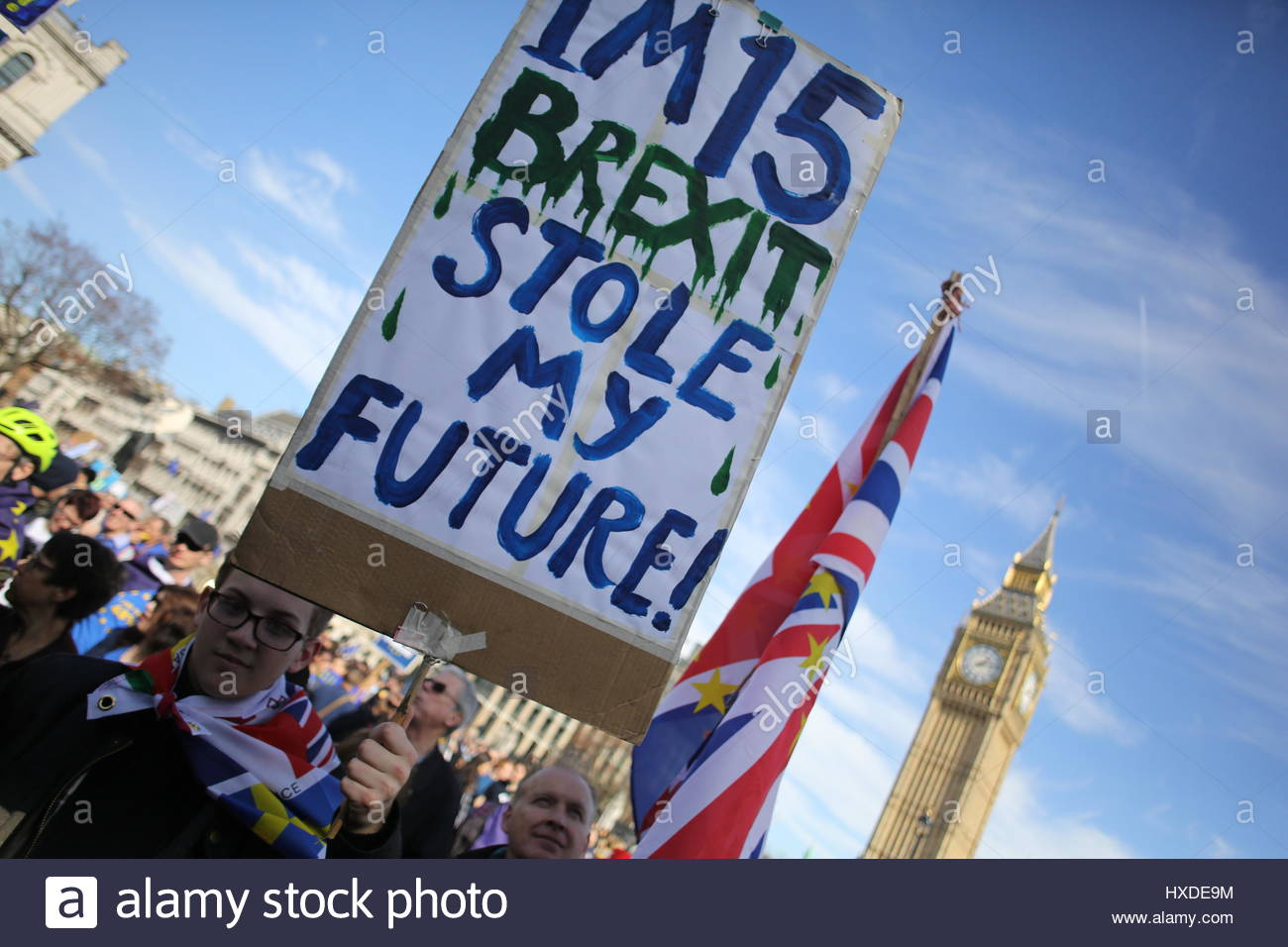 A young man holds a sign up to the camera during the Unite for Europe rally at Westminster four days before the - Stock Image